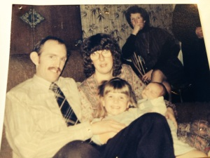 Three year old me with my mum, dad and very new baby brother.